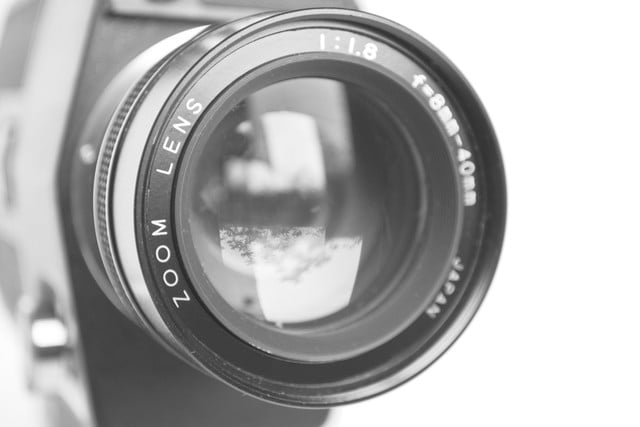 digital cameras zoom vs optical  camera lens isolated on white background