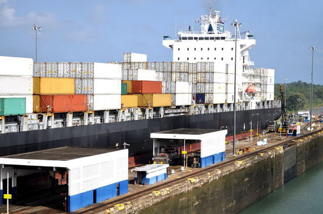 panama canal expansion opens  big container ship in a sluice gate the