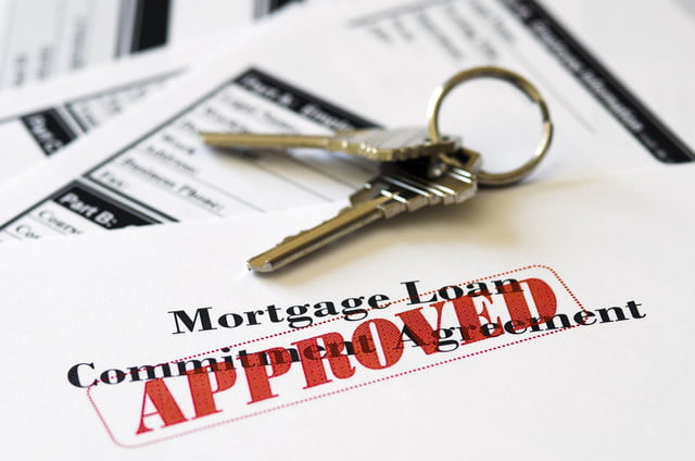 approved loan mortgage documentation system  real estate document with house keys