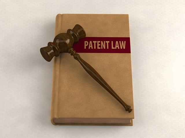 canon patents  gavel on a patent law book conceptual illustration