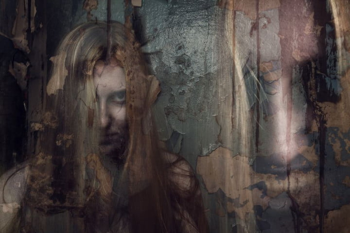 15725867 - double exposure of ghost girl in abandoned building