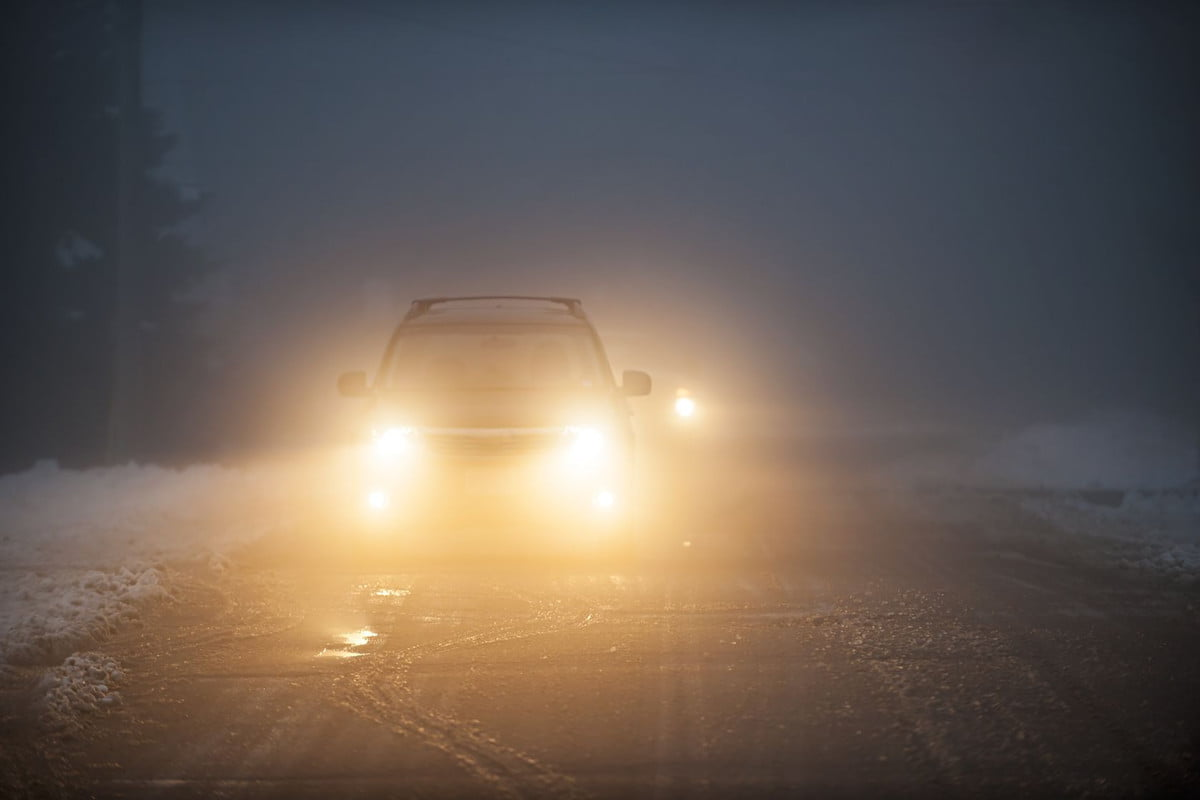 us drivers uncomfortable driving nighttime  bright headlights of a car on foggy winter road