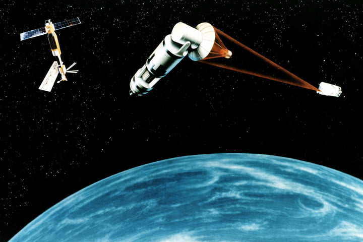 weaponized satellites and the cold war in space  artist s concept of a generic laser equipped satellite firing on another