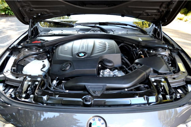 2012 BMW 335i review exterior engine hood up sedan review