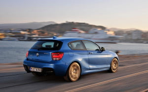 BMW M135i rear three-quarter view motion