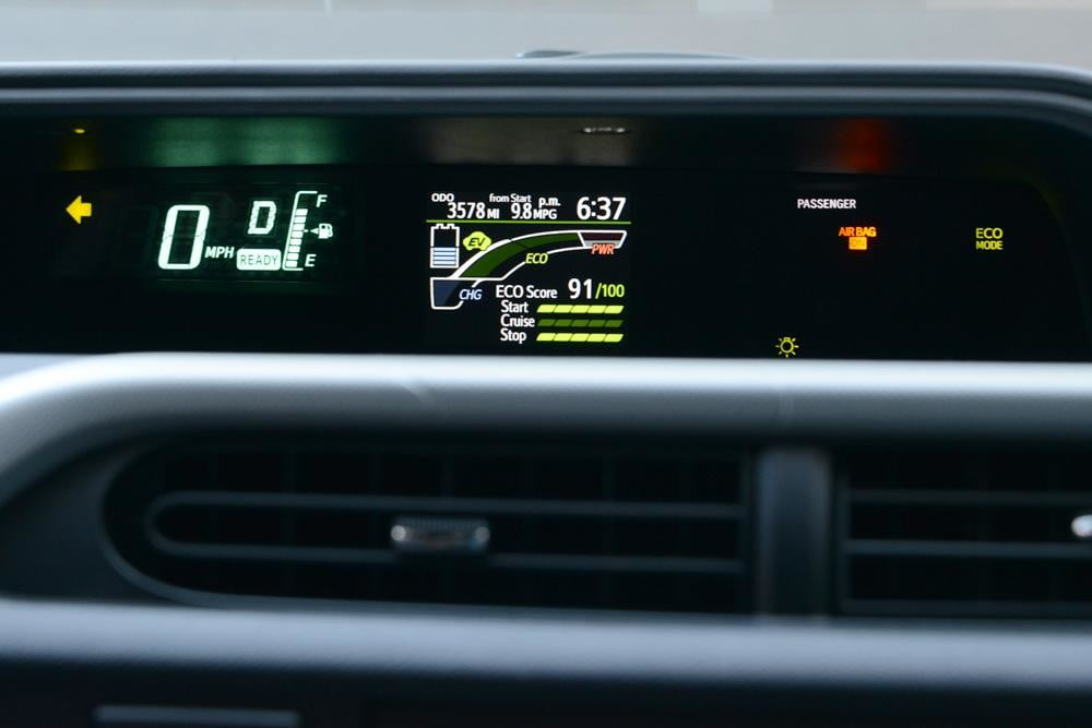 2012 Toyota Prius C Review dash cluster hybrid car