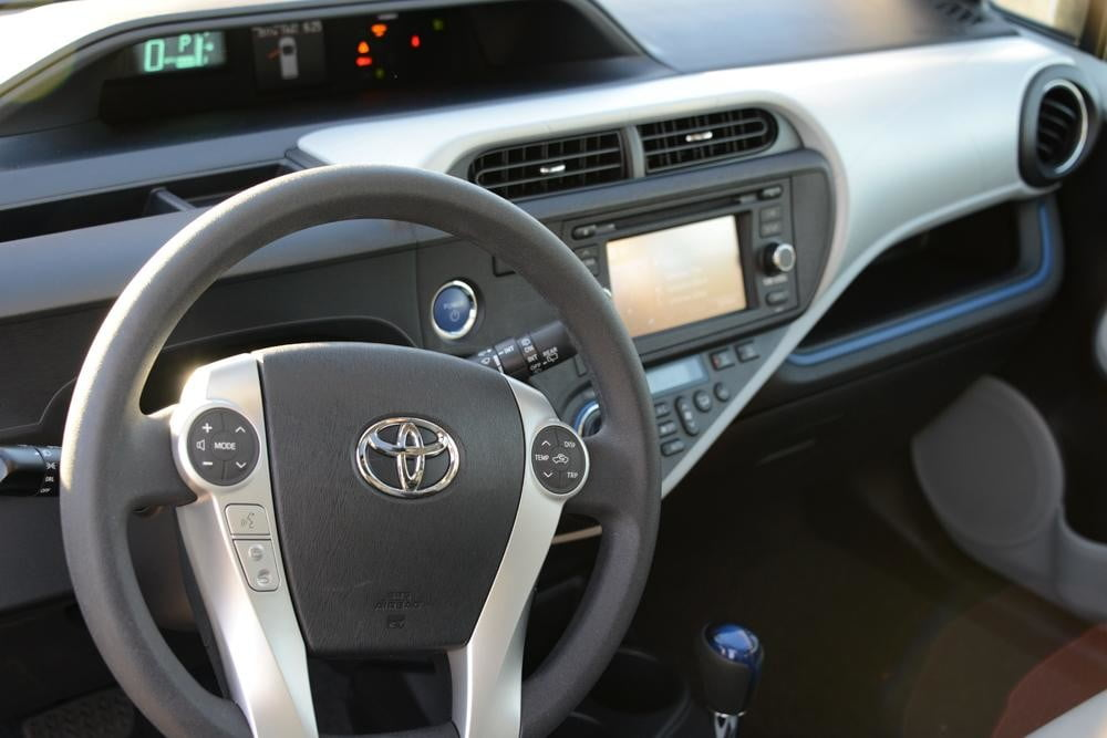 2012 Toyota Prius C Review steering wheel dash hybrid car