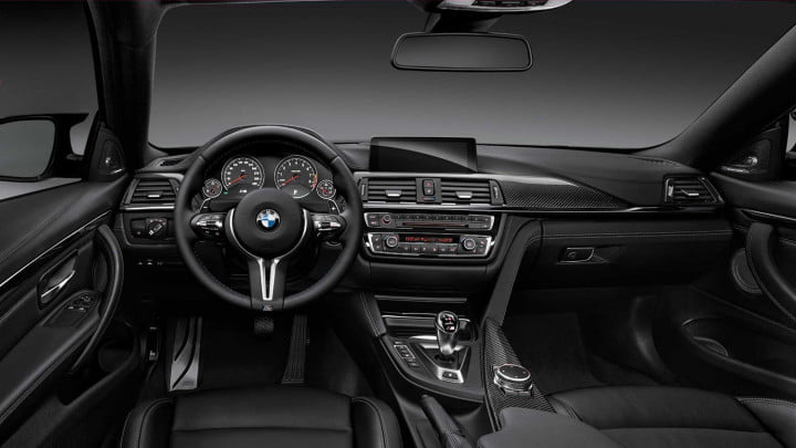 2014 BMW M4 Coupe interior front driver view