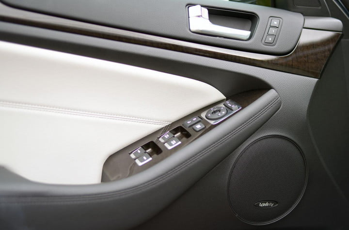 kia cadenza review interior front driver side door