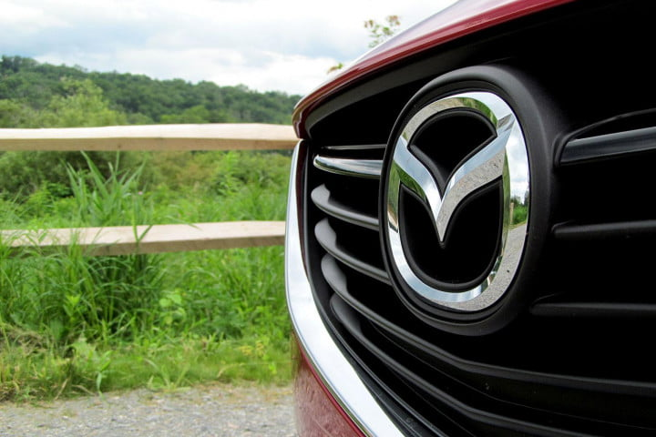 mazda i touring review front logo
