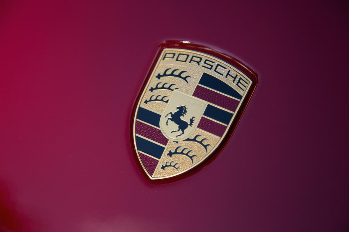 porsche  mid engined supercar on hold for now panamera logo