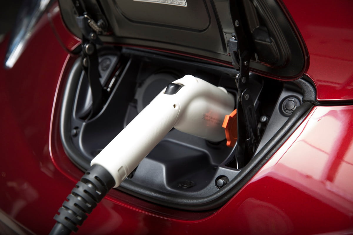 apple investigating electric car charging stations  nissan leaf port