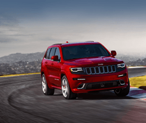 You've never seen 5,000 pounds move as fast as Jeep's Grand Cherokee SRT
