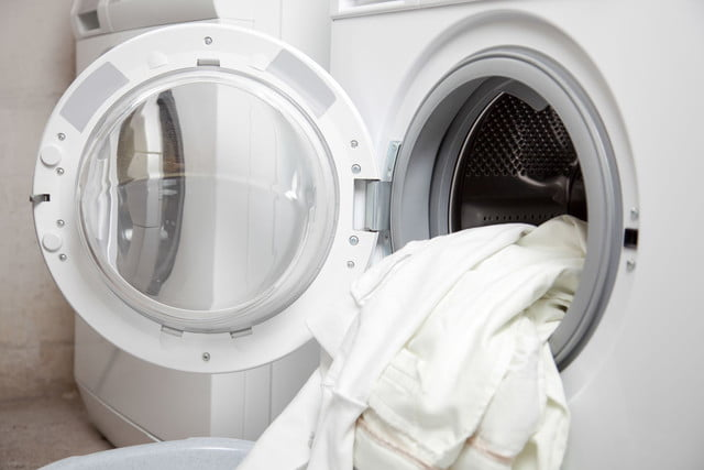 counterfeit laundry detergent tide gain downy  some dirty clothes in the washing machine