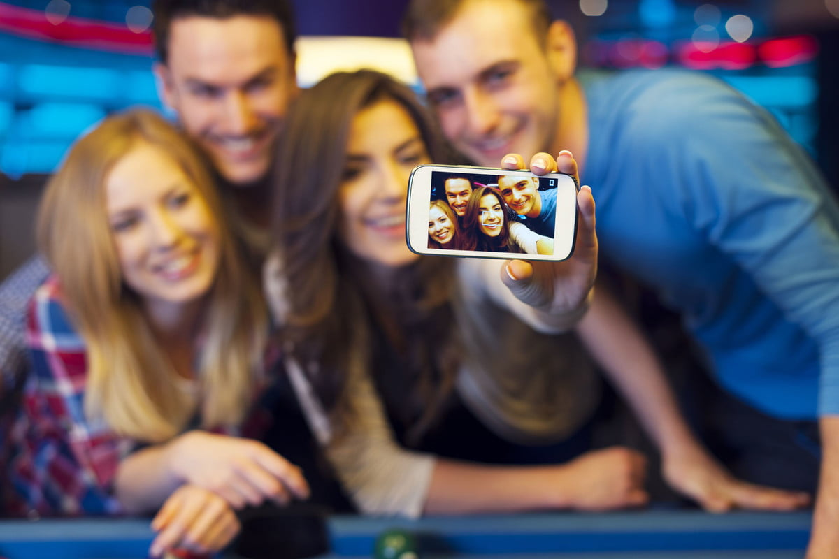 digital photography engineering prize  smiling friends taking selfie photo from nightclub with billiard