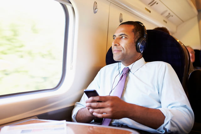 iheartmedia launches two new streaming services  businessman relaxing on train listening to music
