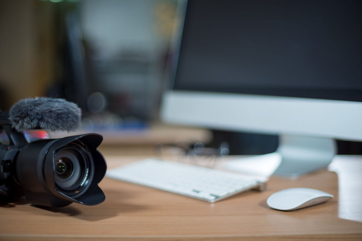 slimraw version  video editing workstation with camera beside monitor