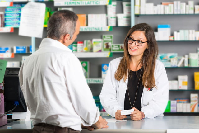 blink health free prescription med discount program  pharmacist and client in a drugstore