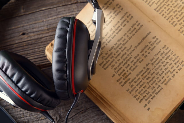 estories audiobook  headphones on the old book concept of listening to audiobooks