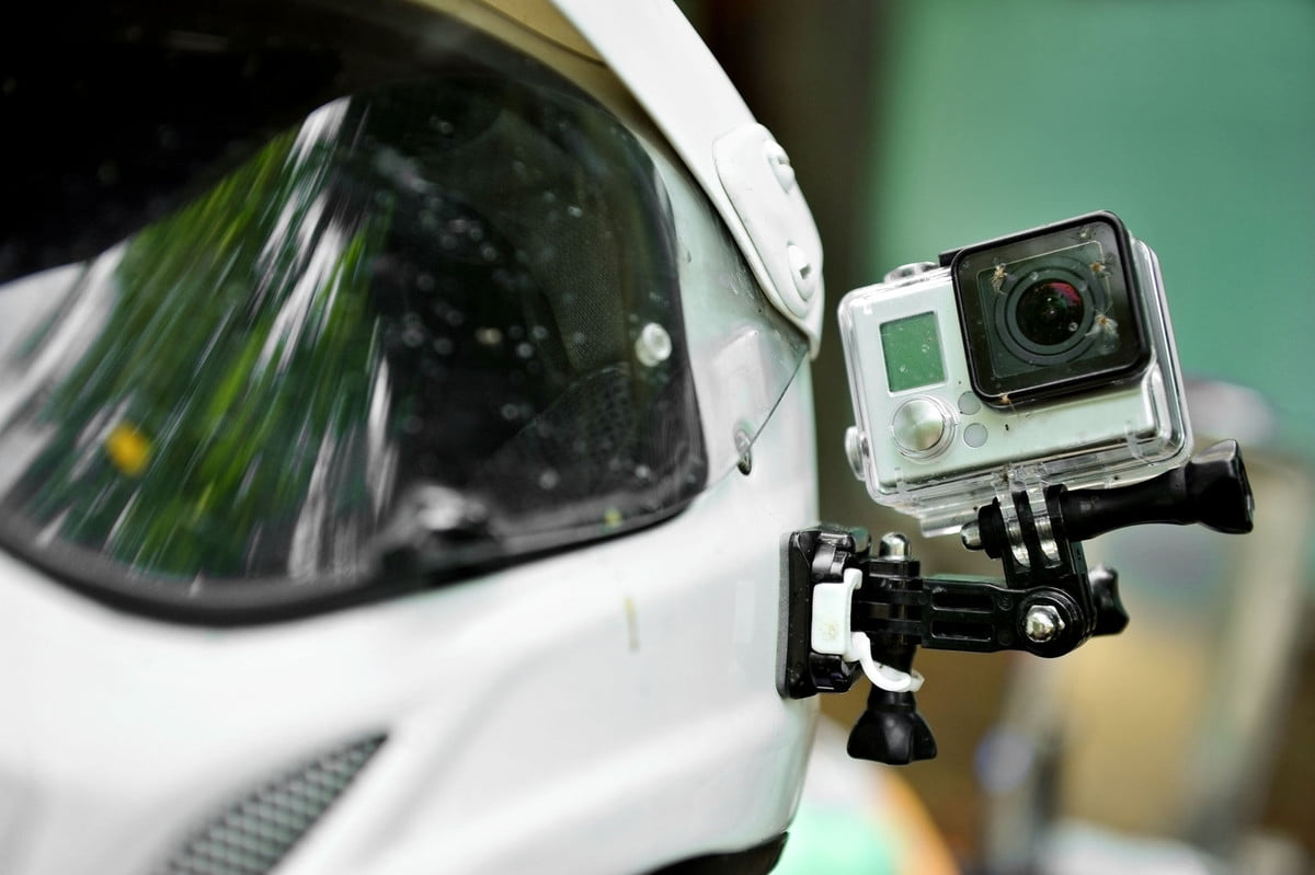 study says action camera sales will triple  with dead insects mounted on a motorcycle helmet