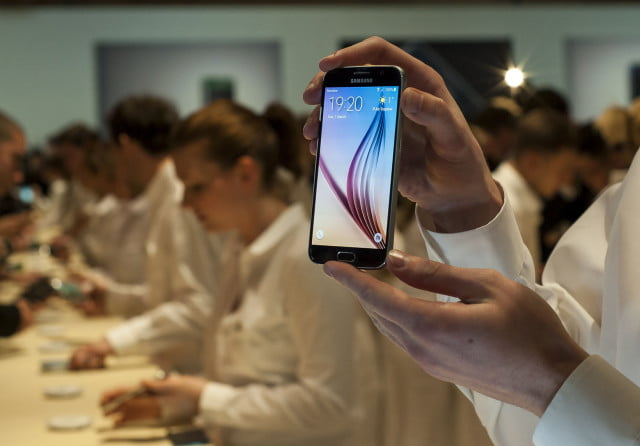 samsung rumored to release one flagship phone annually public hand display