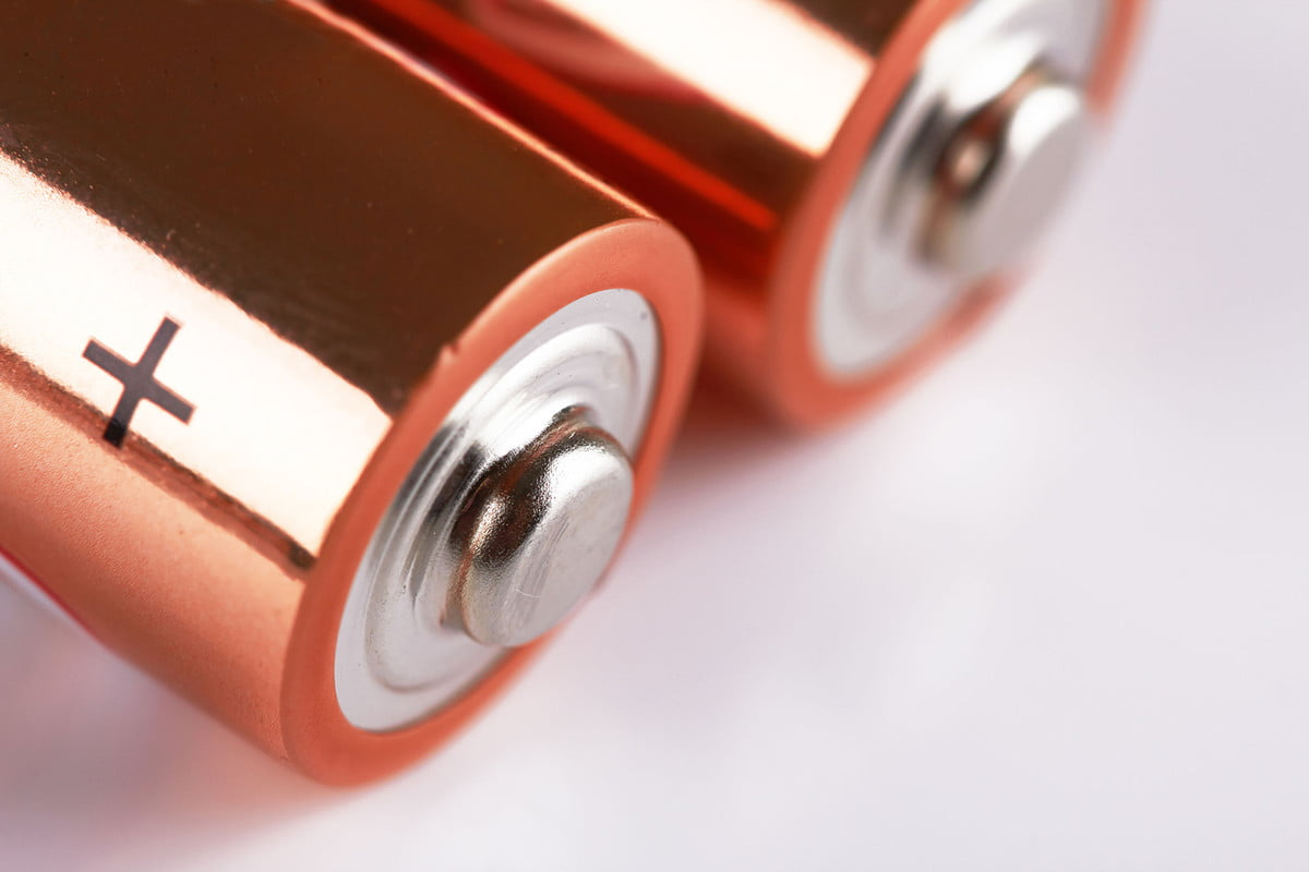 how to clean up battery acid  two orange alkaline batteries macro on white