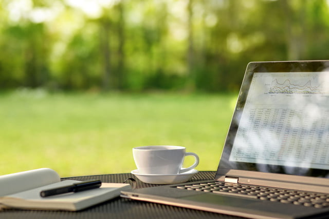 box cloud storage desktop app  laptop and coffee in outdoor office