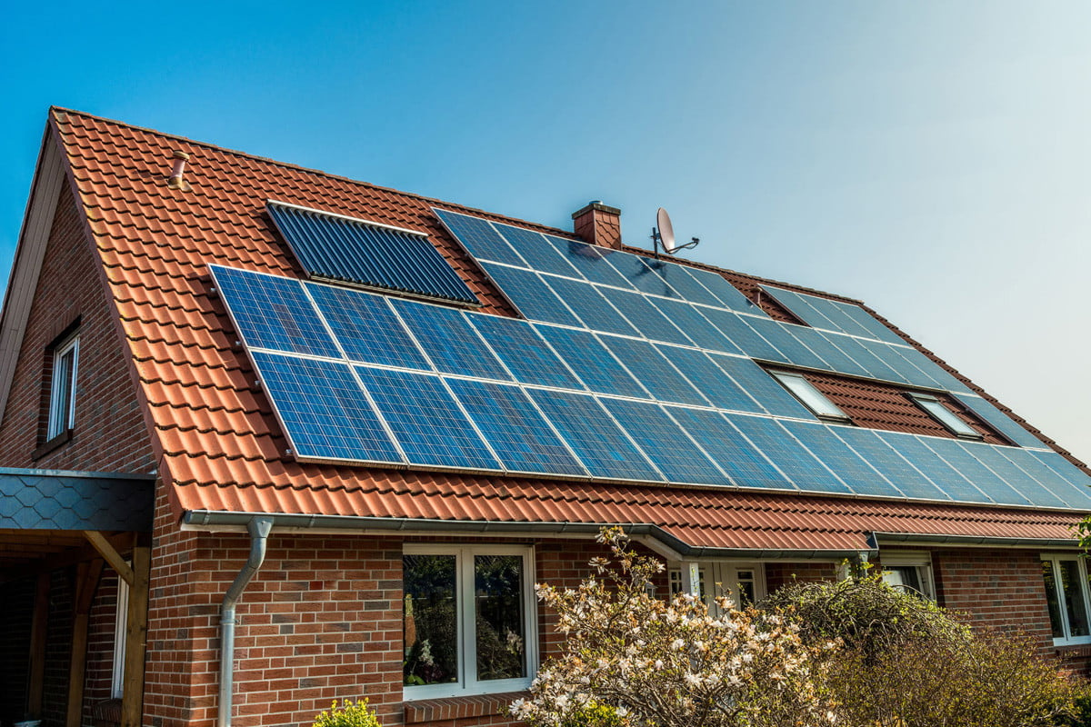 solarcity and airbnb announce new collaboration  solar panel on a red roof