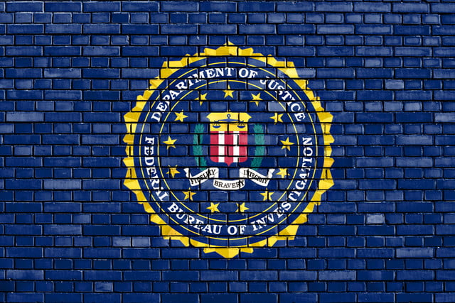 fbi report gamergate investigation  flag of painted on brick wall