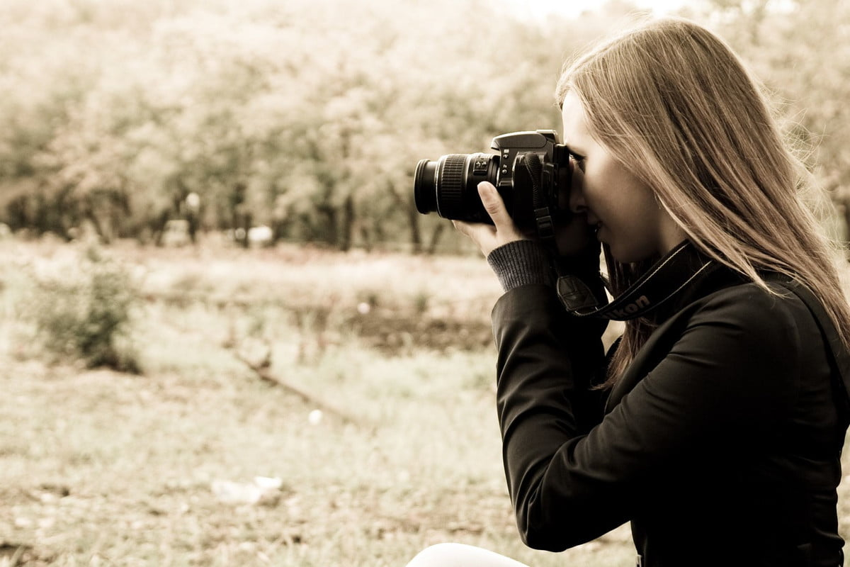 digital camera buying guide  woman the photographer on nature