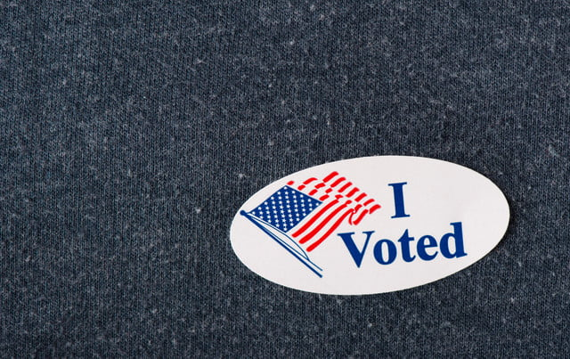 where ballot selfies are illegal  closeup of an american i voted sticker placed on a navy shirt