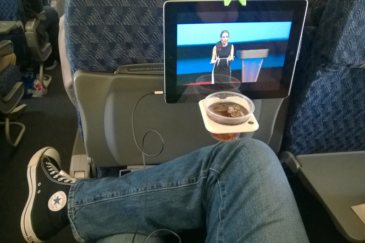 hate cramped airplanes the airhook holds your tablet and a drink