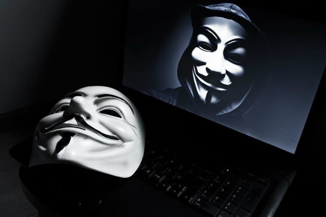 anonymous hacks japan to protest whaling mask and laptop