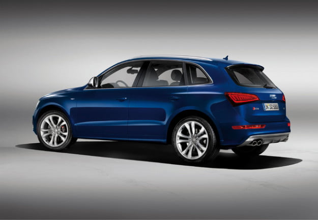 Audi SQ5 gray background rear three quarter view