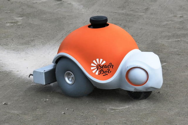 watch disneys new turtle shaped robot draw intricate sand pictures beach beachbot