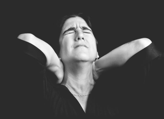 text neck smartphone black and white portrait of a stressed woman suffering from pain