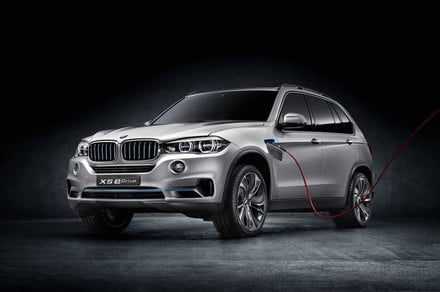 BMW X5 eDrive concept front three quarter plugged in