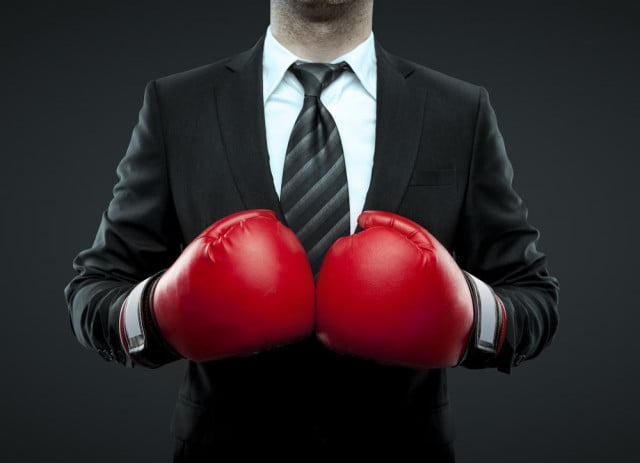 twitter cage wars sprint and t mobile ceos go head to again boxing gloves shutterstock
