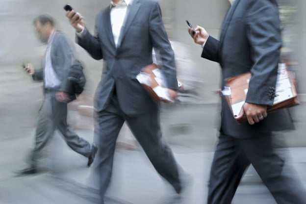 business men cell phone walking