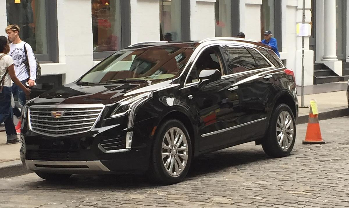cadillac xt  spied pictures specs news rumors front angle