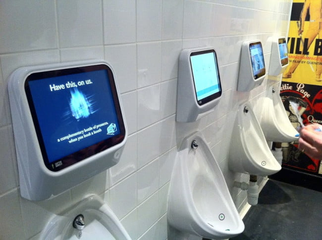 captive media urinals