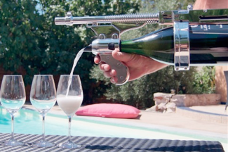 This champagne gun is a real thing, for when putting your thumb on the bottle isn't enough