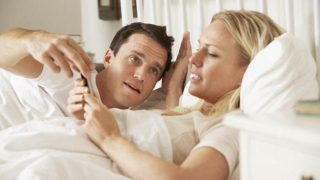Checking smartphones in bed