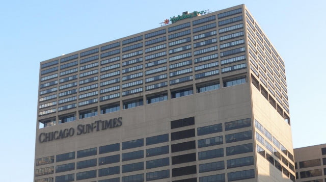 chicago sun times owner agrees rehire four staff photographers replaced iphones building