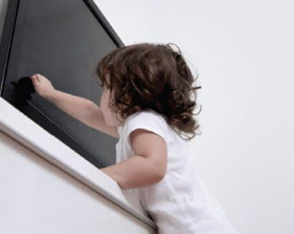 child-reaching-for-television