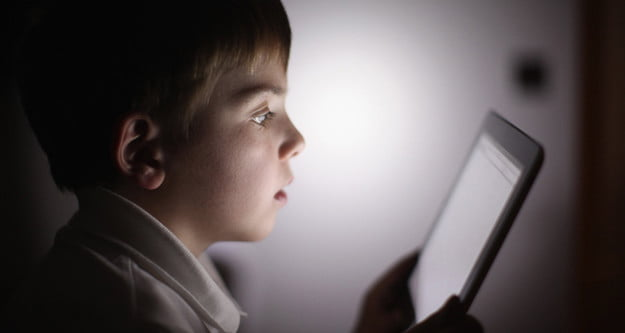 child using tablet growing up with technology