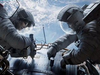 George Clooney and Sandra Bullock star as a pair of stranded astronauts in 'Gravity.'