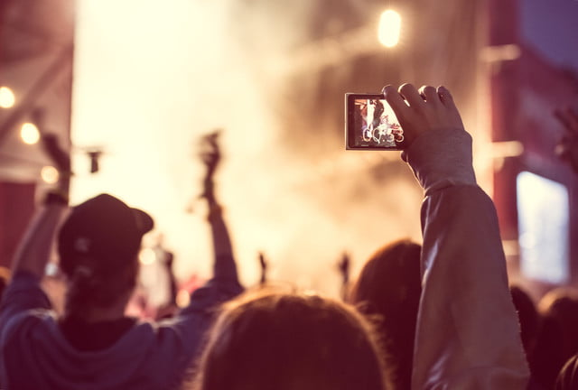 ios  raw support close up of recording video with smartphone during a concert toned picture