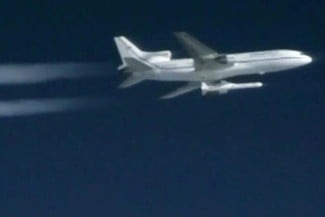 A Pegasus rocket carrying eight small satellites launches from a plane 100 miles east of Daytona Beach, Florida.