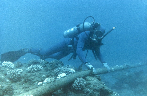 Diver checking underwater cable